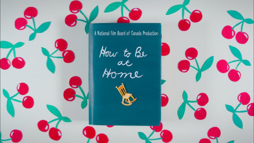 """Ein Buch mit der Aufschrift """"how to be at home"""" auf einem Hintergrund, auf den Kirschen gedruckt sind."""